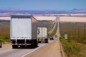 Delivery trucks on a highway. — Stock Photo