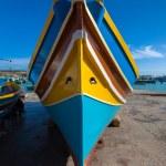 Traditional Maltese colorful boat in Marsaxlokk village — Stock Photo #50425703