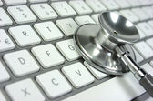 Stethoscope. Computer keyboard. — Foto de Stock