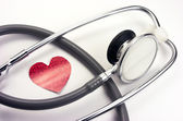 Stethoscope with paper heart — Stock Photo