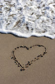 Heart on beach sand — Stock Photo