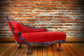 Red sofa in sitting-room with brick wall — Stock Photo