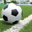 Soccer ball point on cornner, with goal and field — Stock Photo