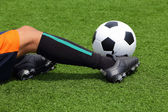 Player slide for catching the soccer ball on grass field — Stock Photo