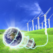 Wind turbines farm energy production to the world — Stockfoto