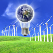 Wind turbines farm energy production to the bulb — Стоковое фото