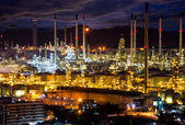 Oil indutry refinery in petrochemical plant at sunset — Stock Photo