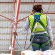 Warehouse worker with safety harness secuerity for fall protecti — Stock Photo #45529229
