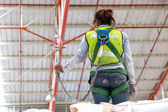 Warehouse worker with safety harness secuerity for fall protecti — Stock Photo