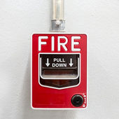 Fire alarm on white wall used to report a fire on the premises — Stock Photo