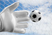 Goalkeeper's hands fail catching the soccer ball with net and bl — Stock Photo