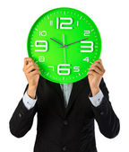 Business man and his clock show best time period — Stock Photo