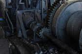 Gears and cogs of machinery — Stock Photo
