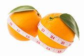 Oranje groenten en meetlint — Stockfoto