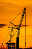 Silhouette of construction crane — Stock Photo