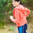 Young woman runner in park  — Stock Photo