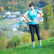 Young beautiful woman doing fitness outdoor — Stock Photo
