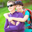 Young beautiful sporty woman and man outdoor — Stock Photo