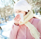 Young woman blowing her nose into a tissue — Stock Photo