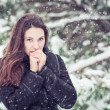 Young woman on winter forest background — Stock Photo #39361657