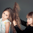 Mother combing her daughter — Stock Photo #39361991