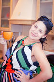 Woman in kitchen with cup of tea — Stock Photo