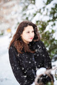 Young woman on winter forest background — Stock Photo