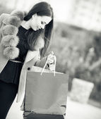 Young woman with shopping bags outdoor — Stock Photo