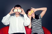 Happy young couple holding fruits — Stock Photo