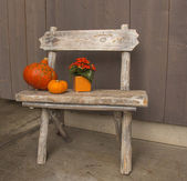 Small wooden Bench with decorations — Stock Photo