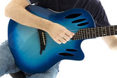 Guitarist with his blue electroacoustic guitar on white background — Stock Photo