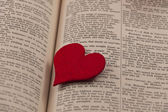 Big red heart on a book page — Stock Photo