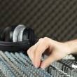 Foto Stock: Closeup of hand adjusting studio mixer