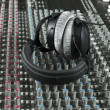 图库照片: Headphone on studio mixer