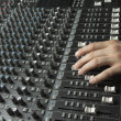 Foto Stock: Hand on studio mixer