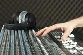 Hand on a studio mixer — Stock Photo