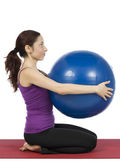 Fitness woman with a pilates ball, vertical — 图库照片