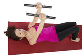 Fitness woman working out with dumbbells — Stock Photo