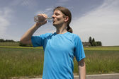 Jogger man refreshing during workout outdoors — Stock Photo