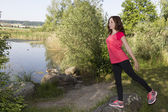 Young jogger woman stretching in nature  — 图库照片