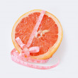 图库照片: Grapefruit with centimetre