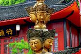 Emeishan, China: Column with Multiple Buddha Faces at Wan Nian Temple — Stock Photo
