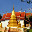 Stock Photo: Kanchanaburi, Thailand: Golden Chedis and Ubosot at Thai Temple
