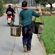 China: Farmer Carrying Water Buckets in Pengzhou — Stock Photo