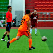 China: Athletes Playing Football — Stock Photo #35088897