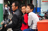 China: Two Brothers Riding on Motorycle with their Father — Stock Photo