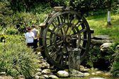 Chengdu, China: Little Boys and Wooden Water Wheel — Stock Photo