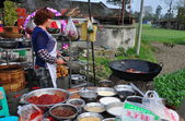China: Woman Cooking at Wok for Wedding Luncheon — Stock Photo