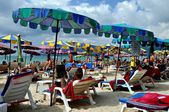 Patong, Thailand: Beach with Umbrellas and Deck Chairs — Stock Photo