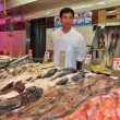 NYC: Fish Vendor at New World Plazin Flushing — Stock Photo #35458867